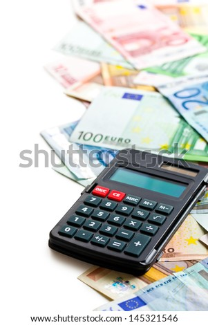 euro banknotes and calculator on white background - stock photo