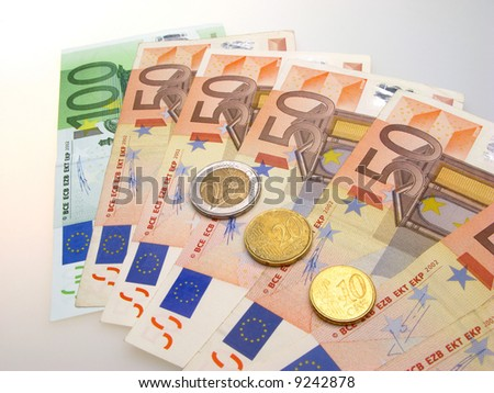 Euro banknotes and cents on light background