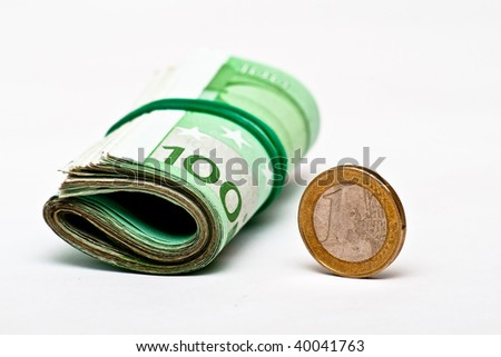 Euro banknotes and coin isolated on white - stock photo