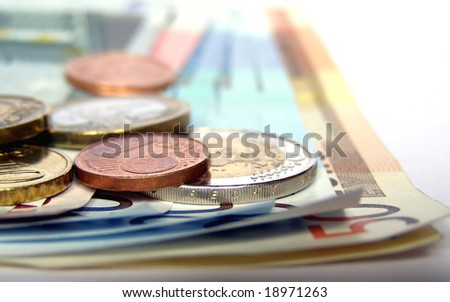 Euro banknotes and coins - stock photo