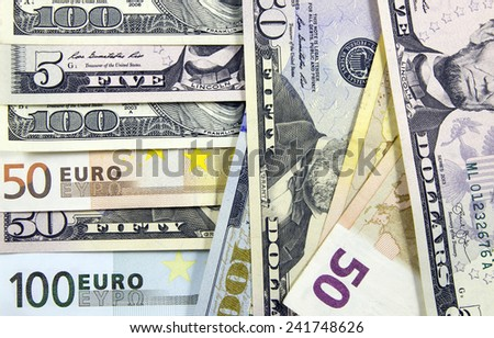 Euro banknotes and dollar banknotes, money background - stock photo
