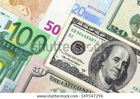 Euro banknotes and dollars of USA overlapping each other - stock photo