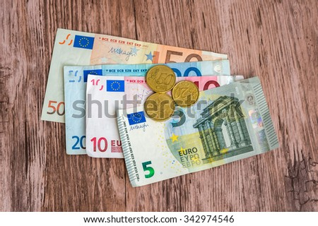 Euro banknotes and euro coins, finance concept - stock photo