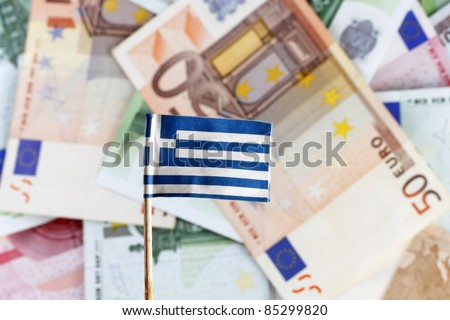 Euro banknotes and greek flag,Greece defaults - stock photo