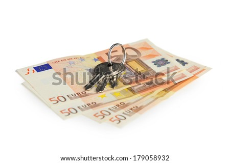 Euro banknotes and keys to the apartment or house against white background - stock photo
