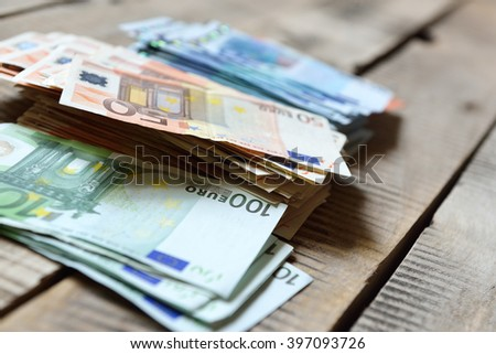 Euro banknotes. Background with european cash money on wooden background. - stock photo
