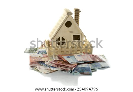 euro banknotes for mortage big wooden isolated house - stock photo