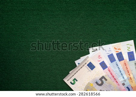 Euro banknotes heap on a green background. Vignette. - stock photo