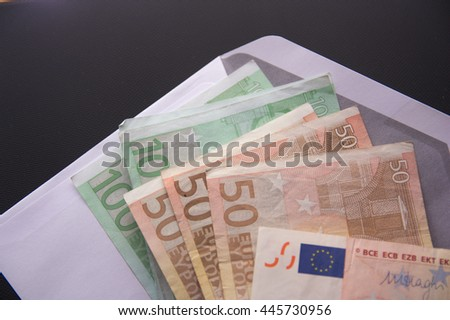 Euro banknotes in an envelope. An envelope with a lot of money in Euro banknotes. - stock photo