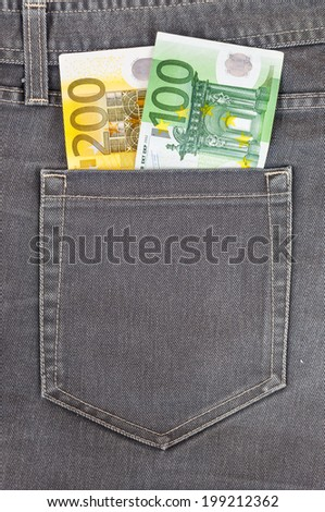 Euro banknotes in dark grey jeans pocket - stock photo