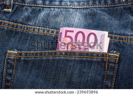 Euro banknotes in jeans back pocket - stock photo
