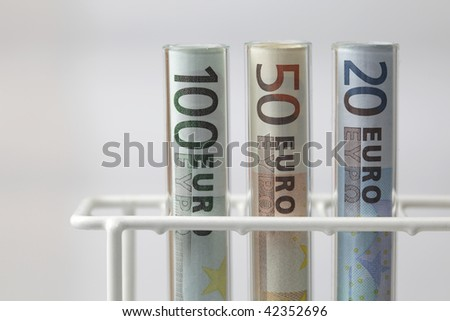 Euro banknotes in Test tubes on white background, health care costs concept