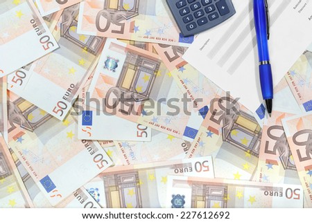 Euro banknotes laid out evenly with document, pen and calculator over them. Financial desktop background - stock photo