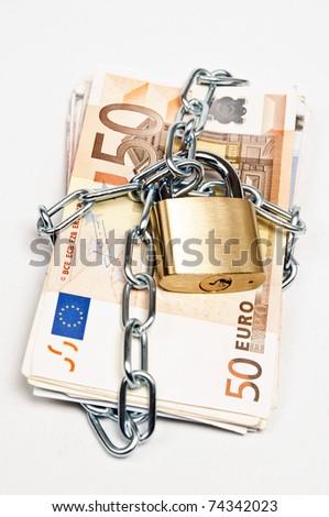 Euro banknotes locked on white - stock photo