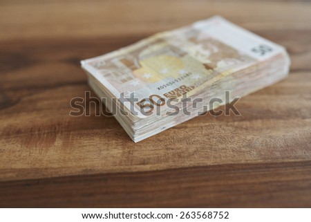 euro banknotes money on the table - stock photo