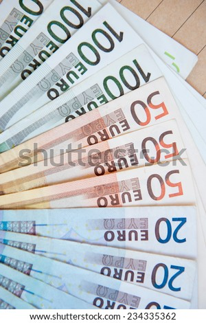 euro banknotes on brown envelope