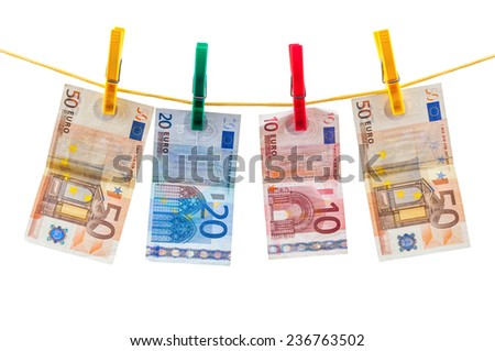 Euro banknotes on clothesline isolated on white background with clipping path - stock photo