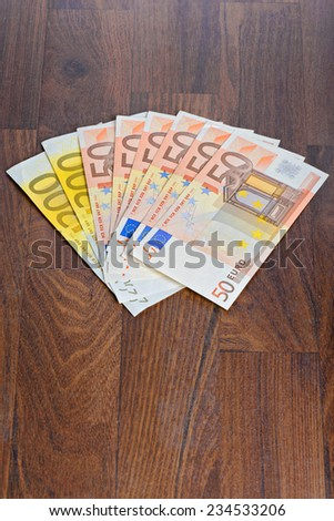 Euro banknotes on the table - stock photo