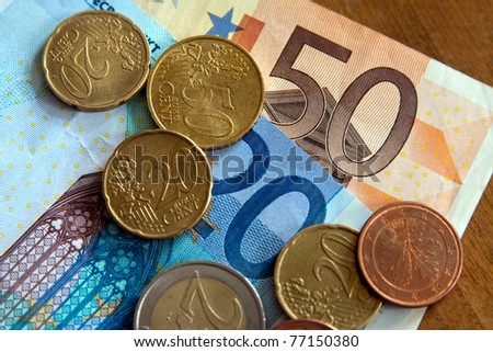 euro banknotes with coins