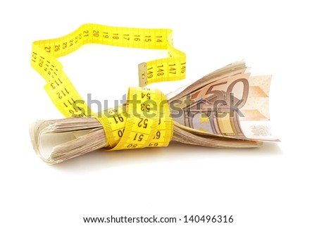euro banknotes with measure tape on white background - stock photo