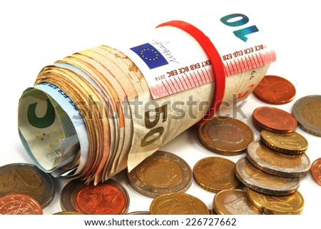 Euro bills rolled and coins - isolated - stock photo