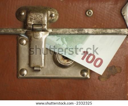 Euro bills within locked case - stock photo