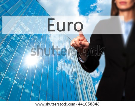Euro - Businesswoman hand pressing button on touch screen interface. Business, technology, internet concept. Stock Photo