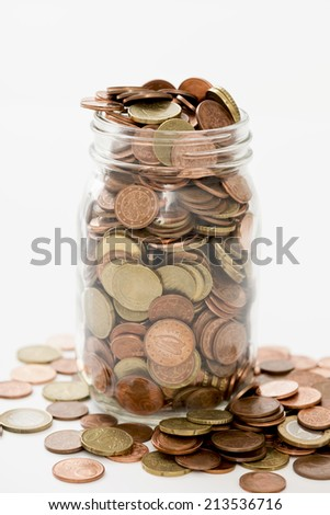 euro cents collected in a glass jar on white background - stock photo