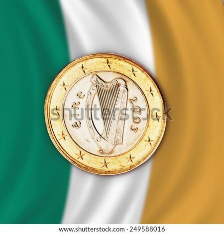 Euro coin against Irish flag, close up - stock photo