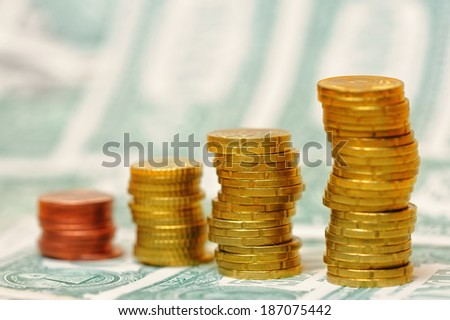 Euro coin columns on USD bank note background
