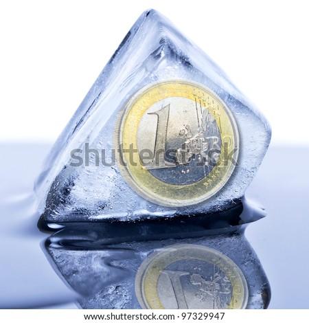 Euro coin frozen into the ice cube - stock photo