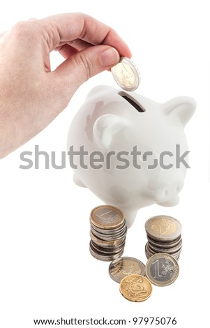 Euro coin into white piggy banks