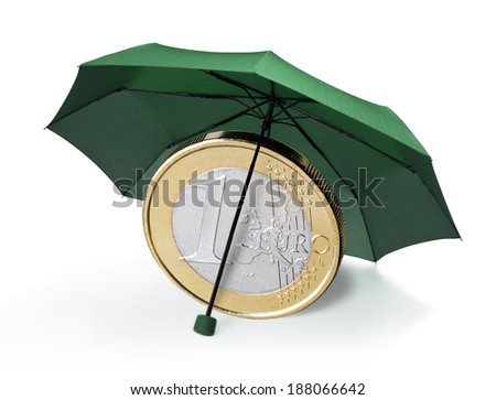 Euro coin is protected by a green umbrella. - stock photo