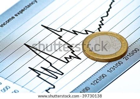 Euro coin on chart - stock photo