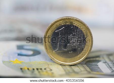 Euro coin on Euro banknote - stock photo
