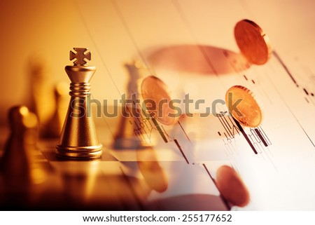 Euro coin on stock chart and chess. Selective focus. - stock photo