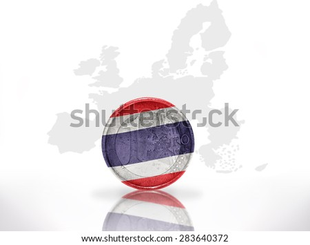 euro coin with thailand flag on the european union map background