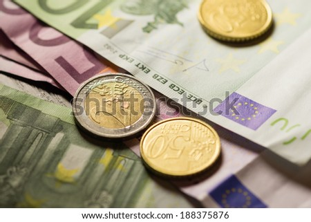 Euro coins and banknotes money. Macro background.