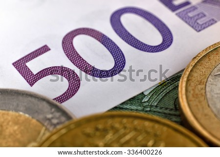 Euro coins and euro banknotes, close up - stock photo