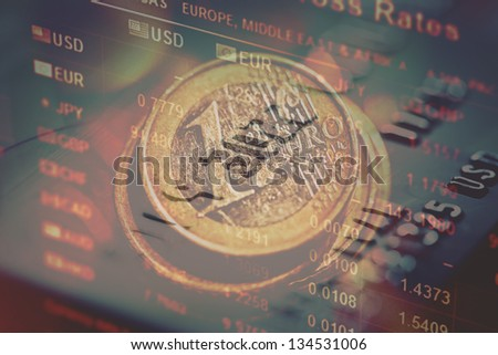 Euro coins and finance data. Selective focus. - stock photo
