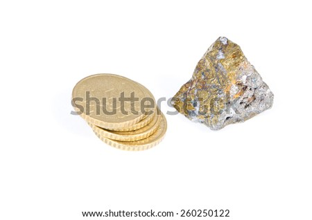 Euro coins and mineral with gold color on a white background - stock photo
