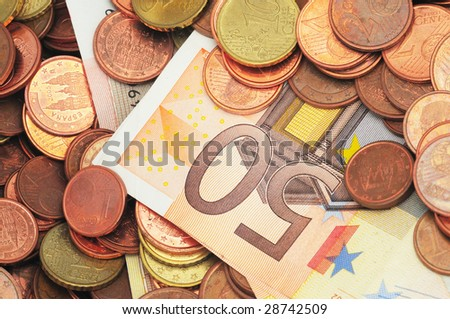 Euro Coins and notes, 50 (fifty) euro note surrounded by coins. - stock photo