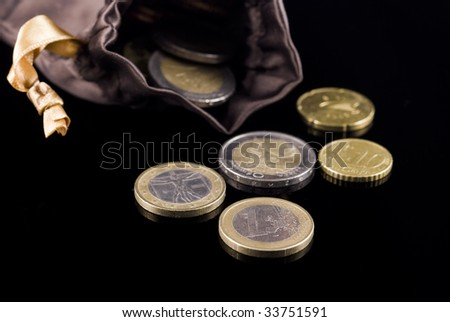 Euro coins arranged on black background - stock photo