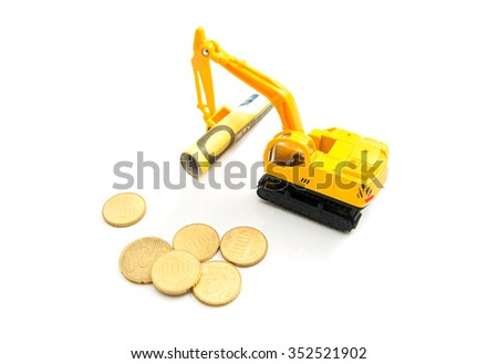 euro coins, banknotes and backhoe on white - stock photo
