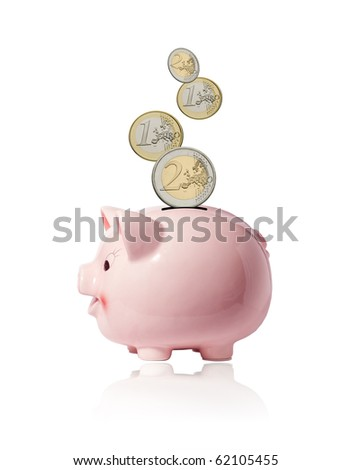 Euro coins falling into a pink piggy bank, isolated on white