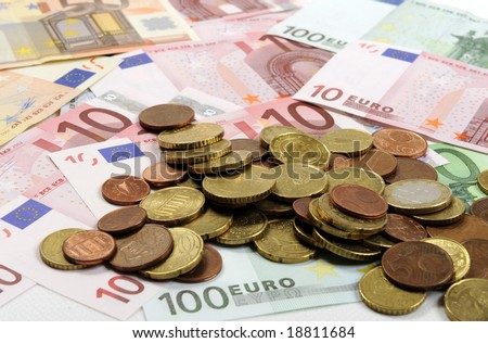 Euro coins falling on euro banknotes, isolated - stock photo