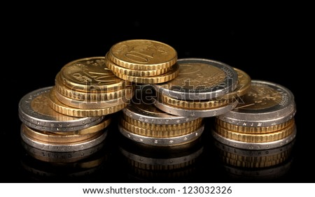 euro coins isolated on black