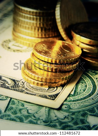 Euro coins on a dollar. Finance system concept. - stock photo