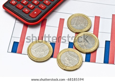 Euro coins on business graph background - stock photo