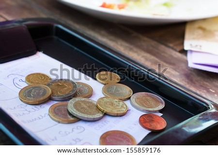 Euro coins on cash receipt from the restaurant.